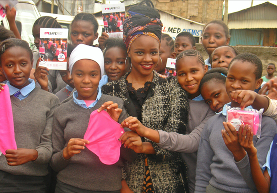 Girls presenting their donated safepad