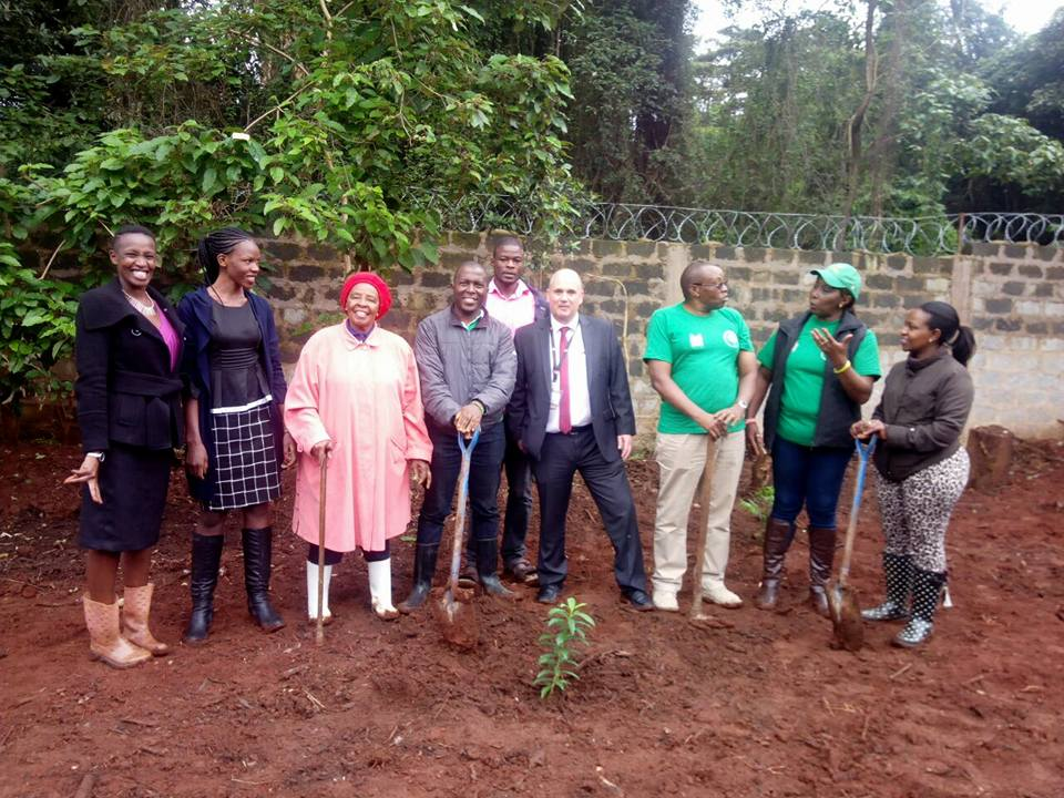People presenting the first Tree planted for the Sanitation Project